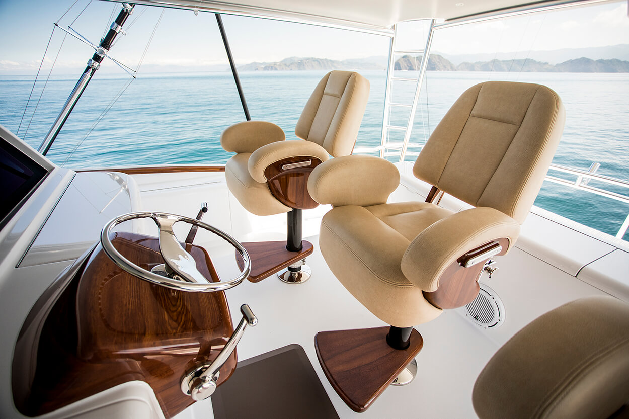 Everett Nautical designs paints sport fishing yachts name faux teak