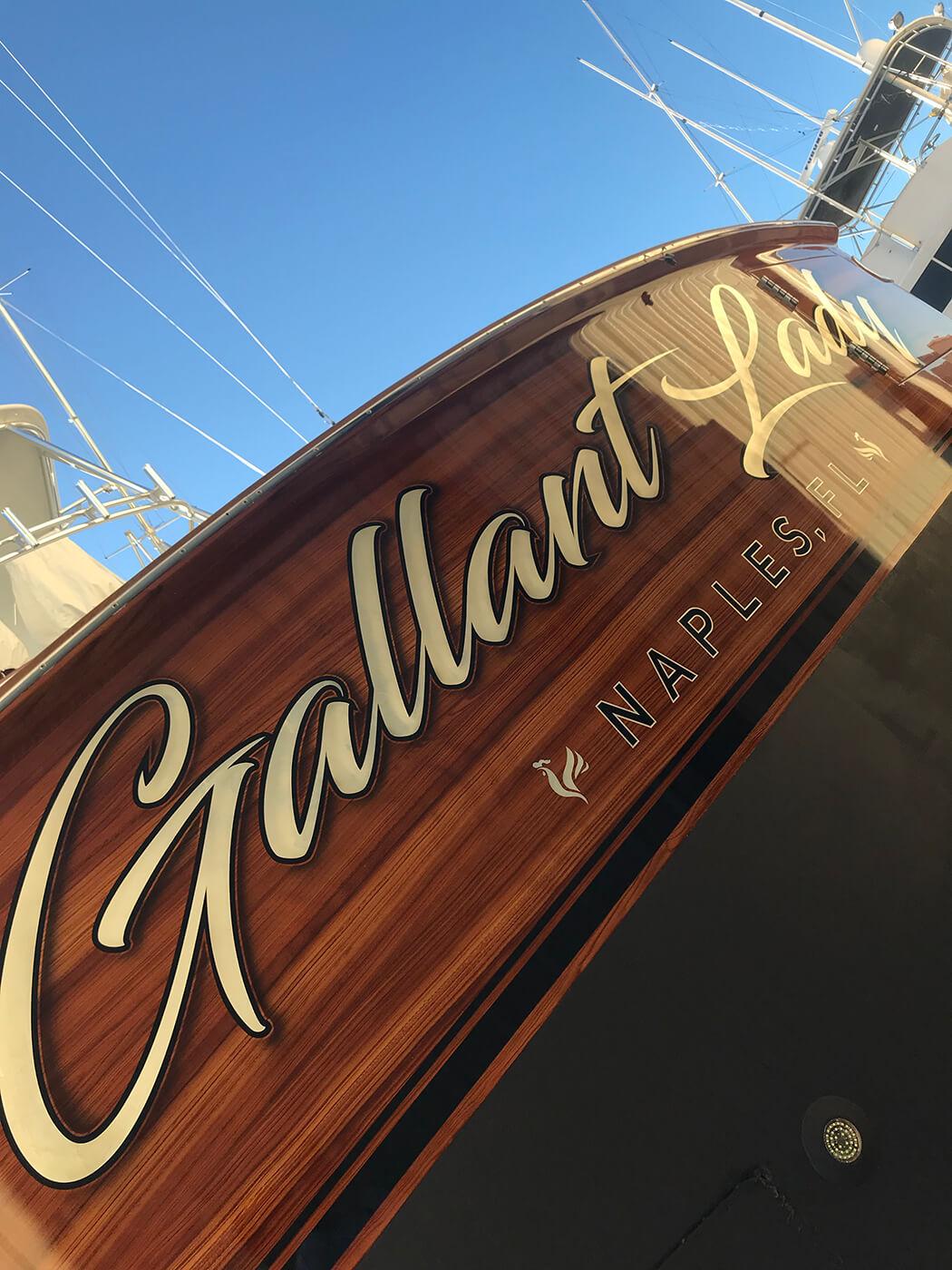 Gallant Lady Naples Florida Faux Teak transom detailed wood