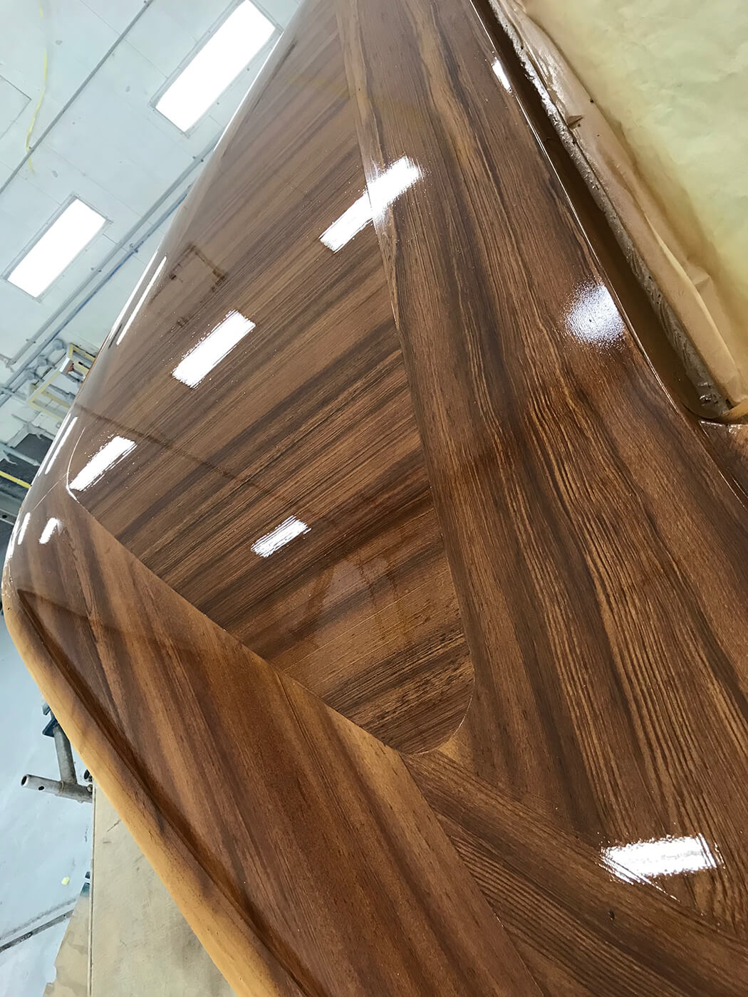 Hatteras Yachts GT65 Faux Teak bow toe rail clear coated