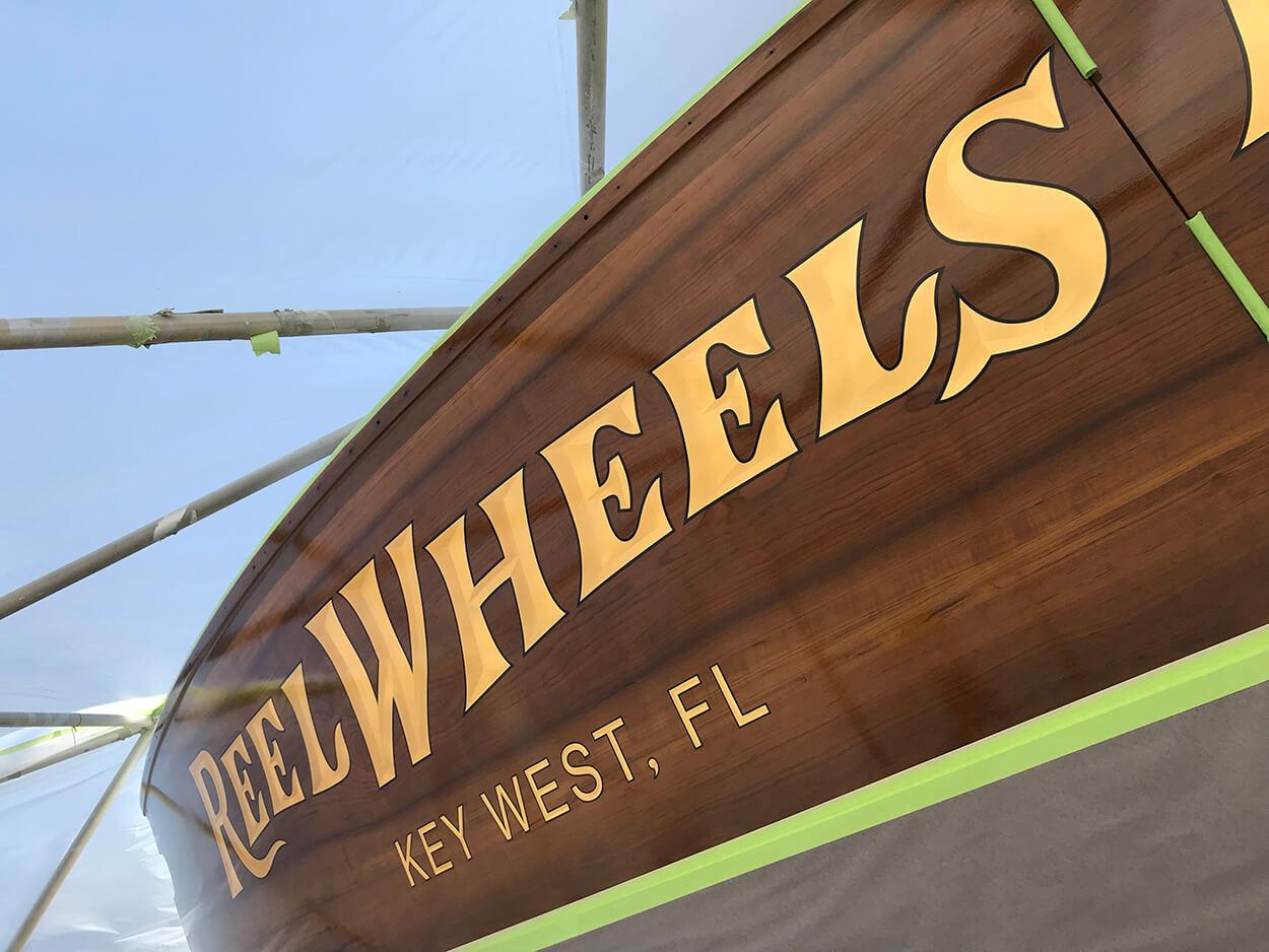 Reel Wheels II Boat Transom