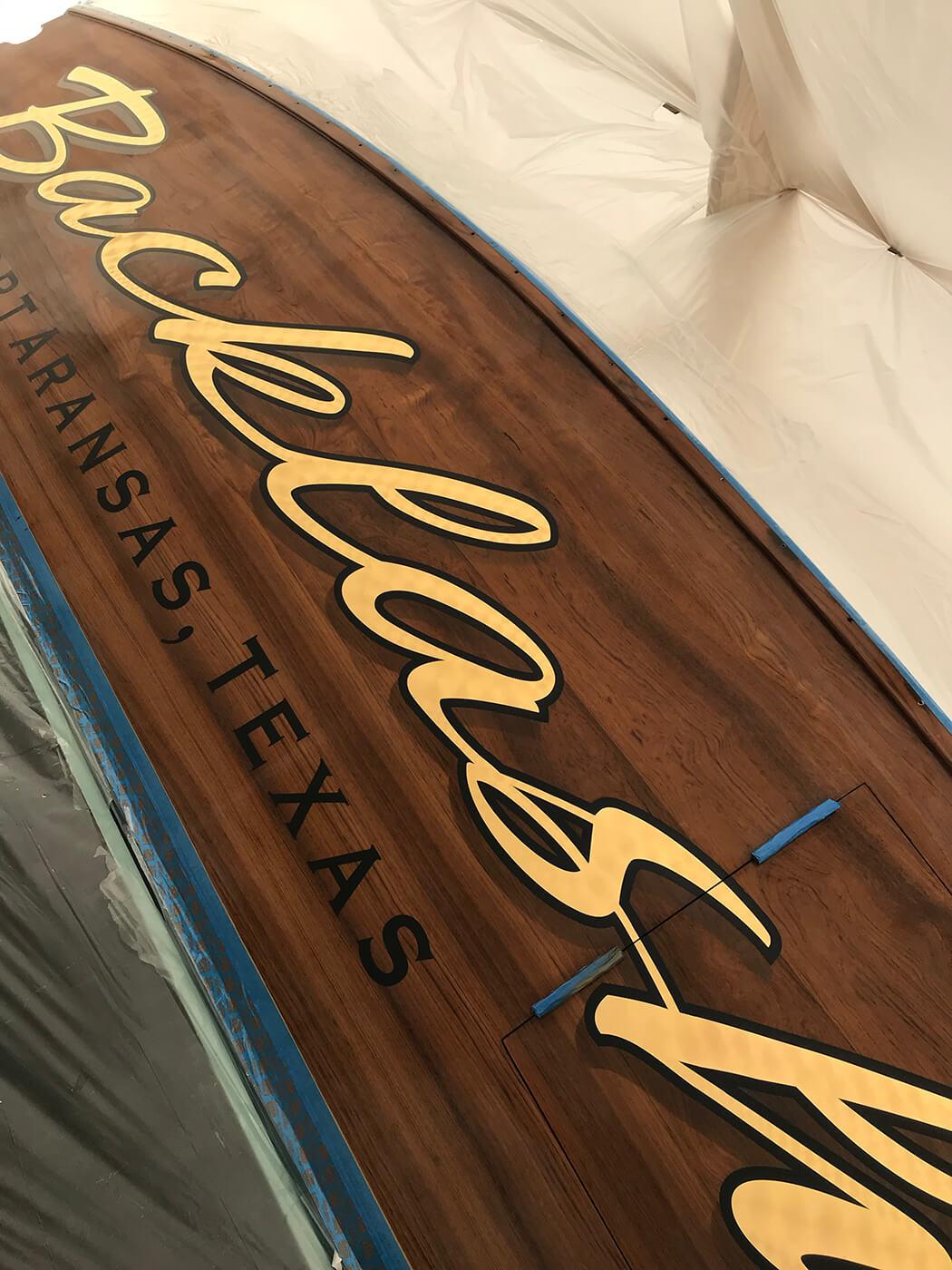Backlash Port Aransas Texas Boat Transom engine turned yellow 24k gold leaf