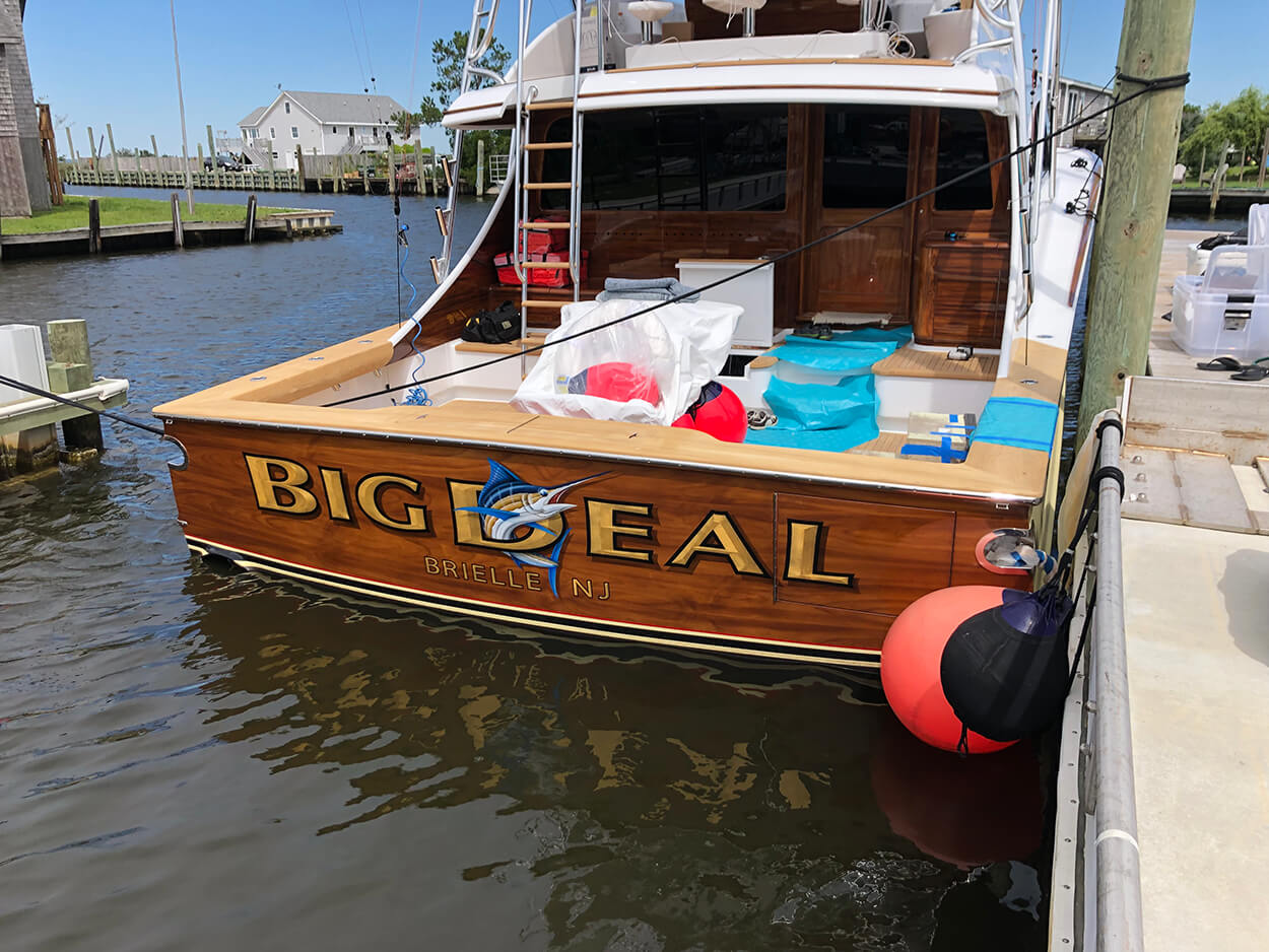 Big Deal Brielle New Jersey Boat Transom in water gold leaf name hard drop shadow