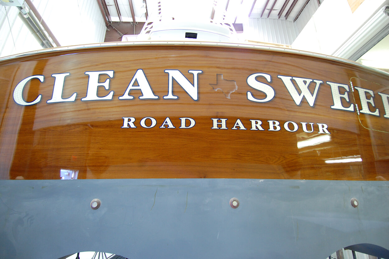 Clean Sweep Road Harbour BVI Boat Transom white engine turned letterforms