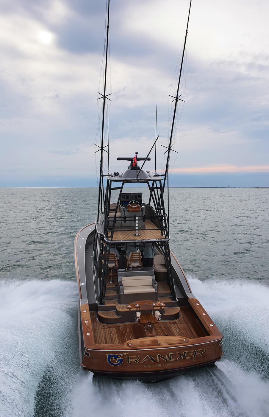 Grander White Bay Boat Transom underway hard drop shadows