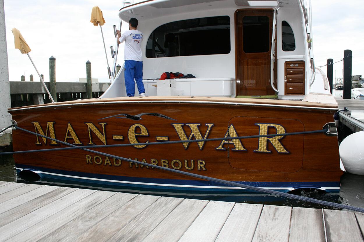 Man e War Road Harbour BVI Boat Transom docked engine turned name letter