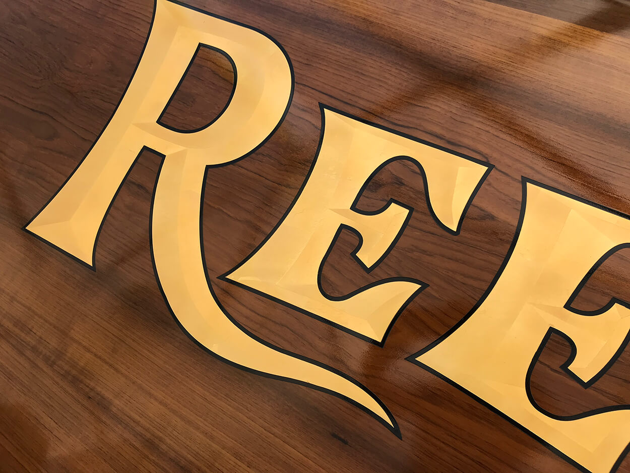 Reel Wheels II Boat Transom letter detail goldleaf