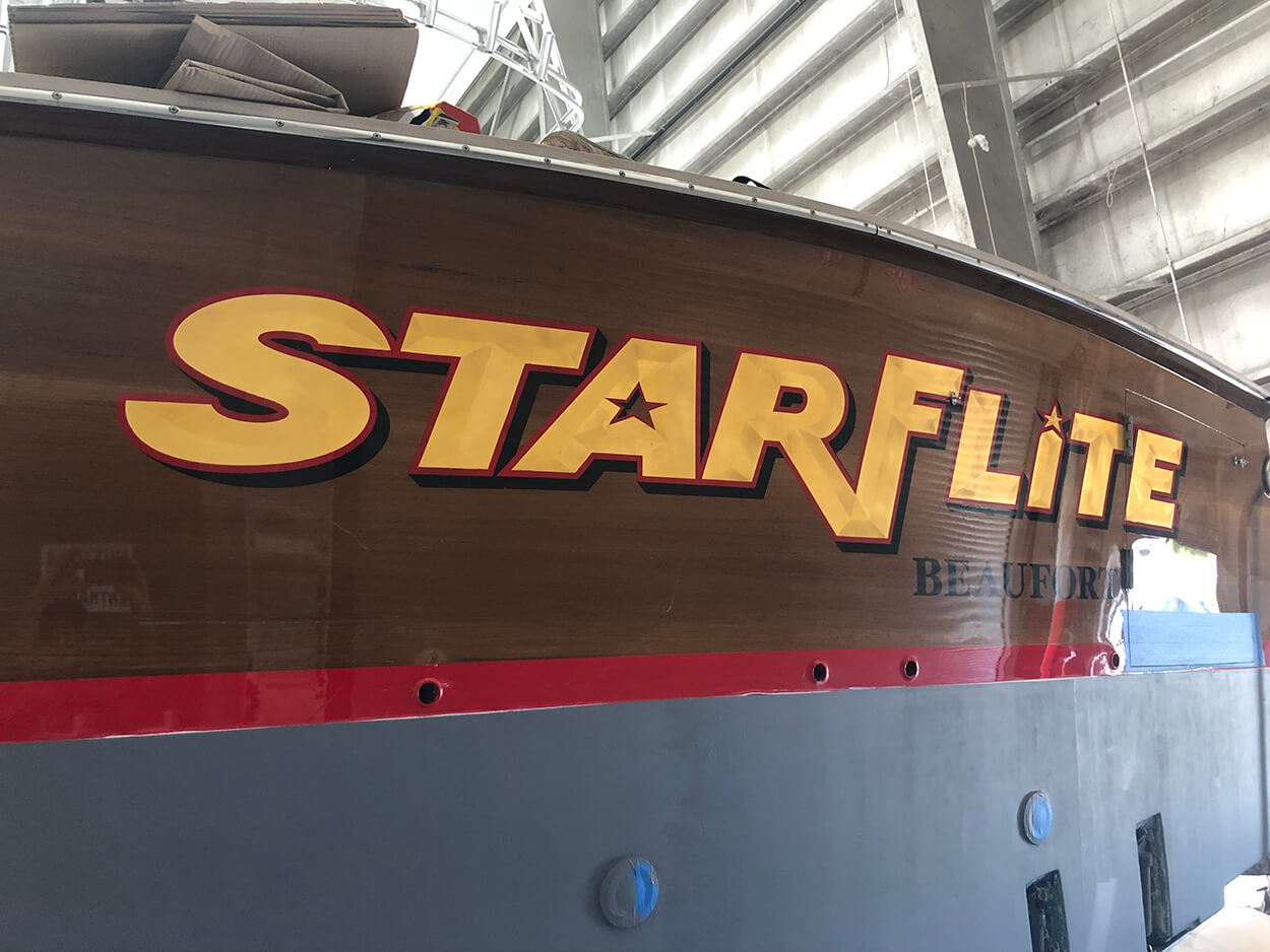 Starflite Beaufort North Carolina Boat Transom yellow gold vessel handpainted airbrushed name