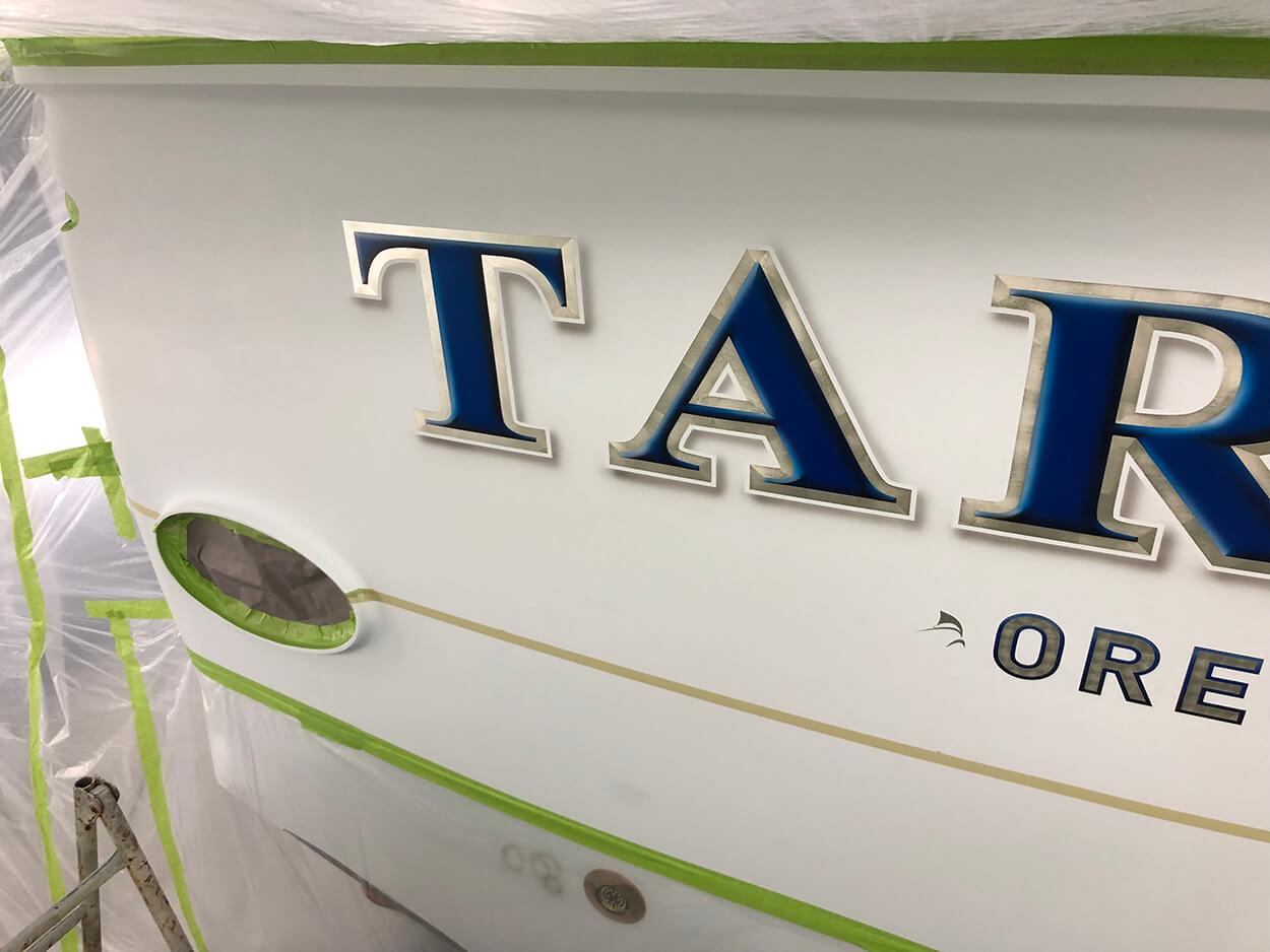 Tarheel Oregon Inlet NC Boat Transom white gold leaf outlines