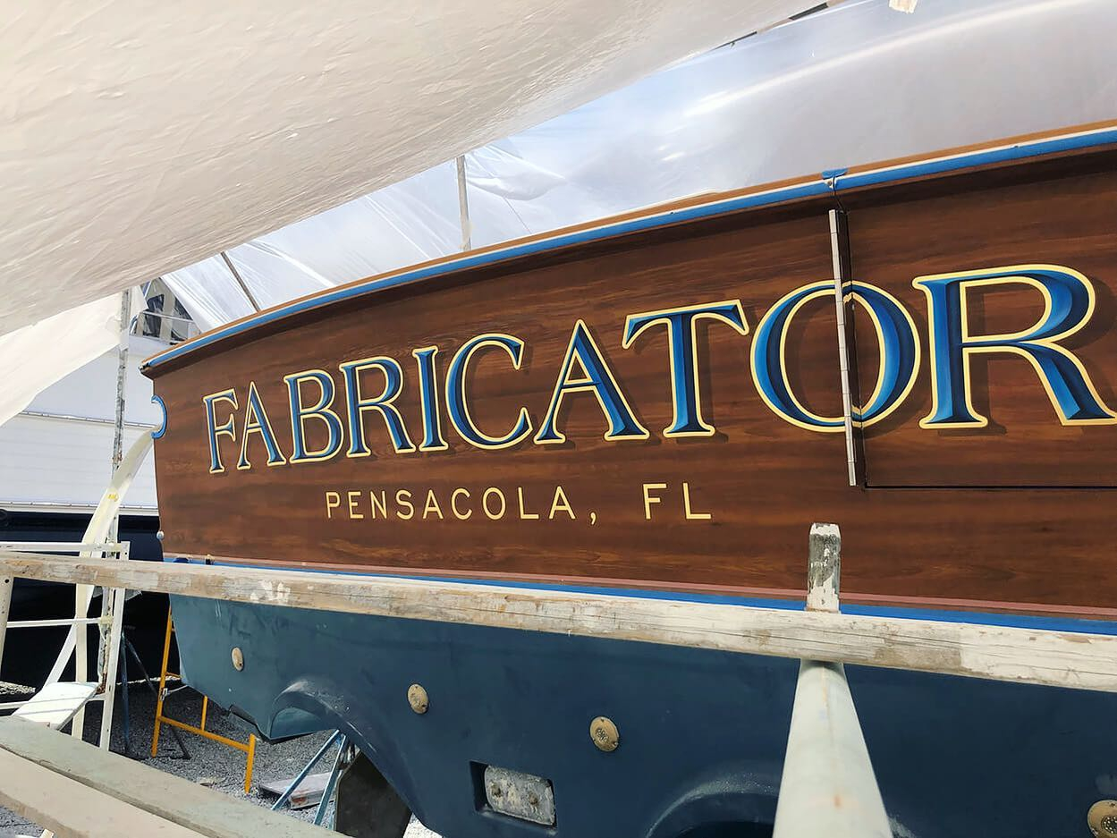 """Fabricator"" features our painted bevel style fill lettering, yellow gold leaf outlines, and a hard drop shadow. @spenceryachts"