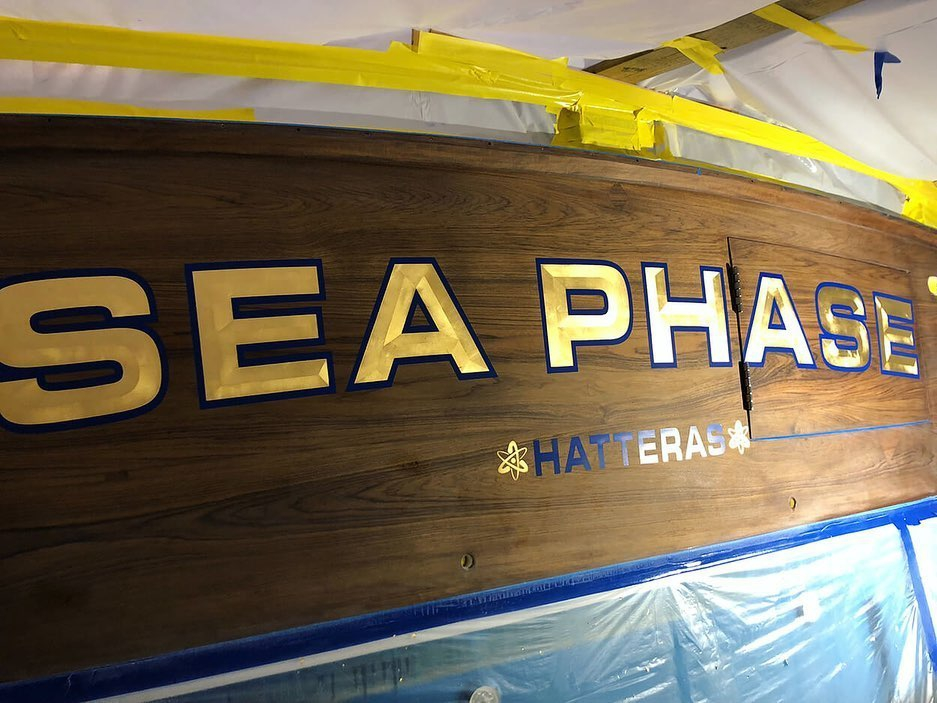 """Sea Phase"" features our bevel style, gold leaf lettering, painted outlines, and gold leaf hailing ports. Buddy Davis Yachts."