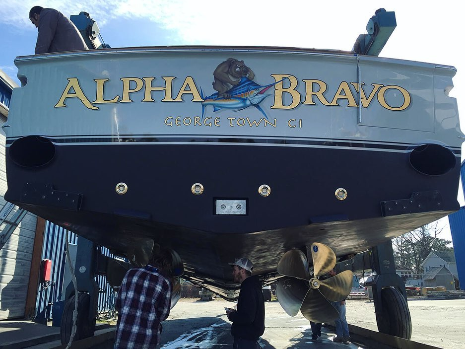 "Shot of ""Alpha Bravo"" out of the water. This transom features our 24 k gold leaf lettering and a custom airbrush graphic . @spenceryachts"