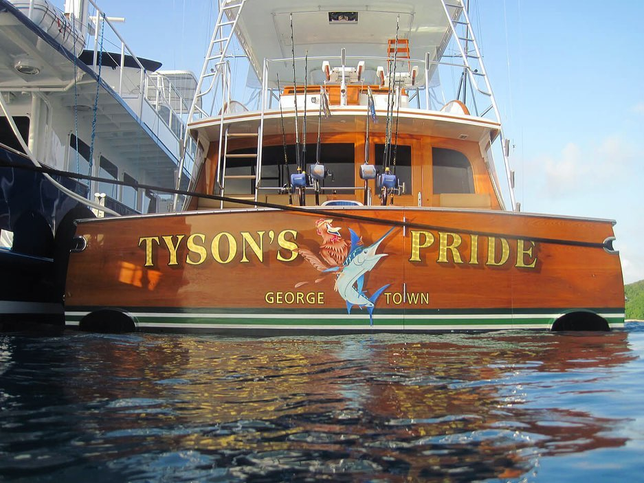 """Tyson's Pride"" showcases our engine-turned 24 k gold leaf lettering, painted outlines, custom airbrush graphic, and hard drop shadow. @merrittboatworks"