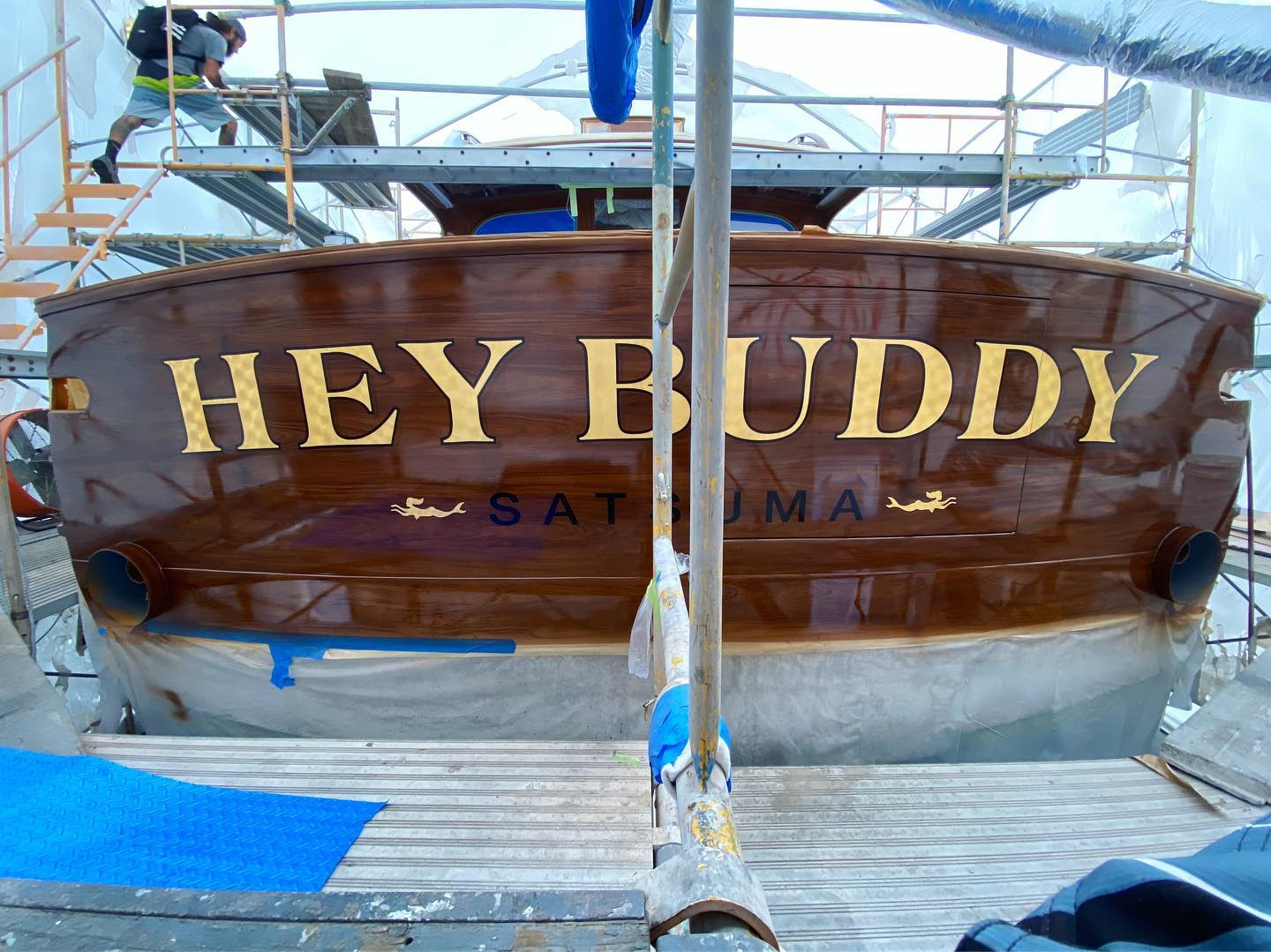 """Hey Buddy"" completed in Fort Lauderdale at Rolly Marine on the famous 'Marina Mile'. This transom features our custom, hand painted, engine-turned 23k gold leaf name with custom gold leaf hailing port graphics. The END crew also protected the underlying painted faux teak with several clear coat applications using AWLGrip 2000."
