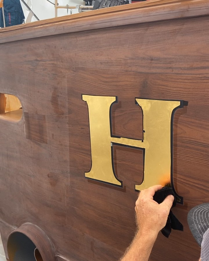 Engine-turned, 24 k gold leaf lettering being applied today.