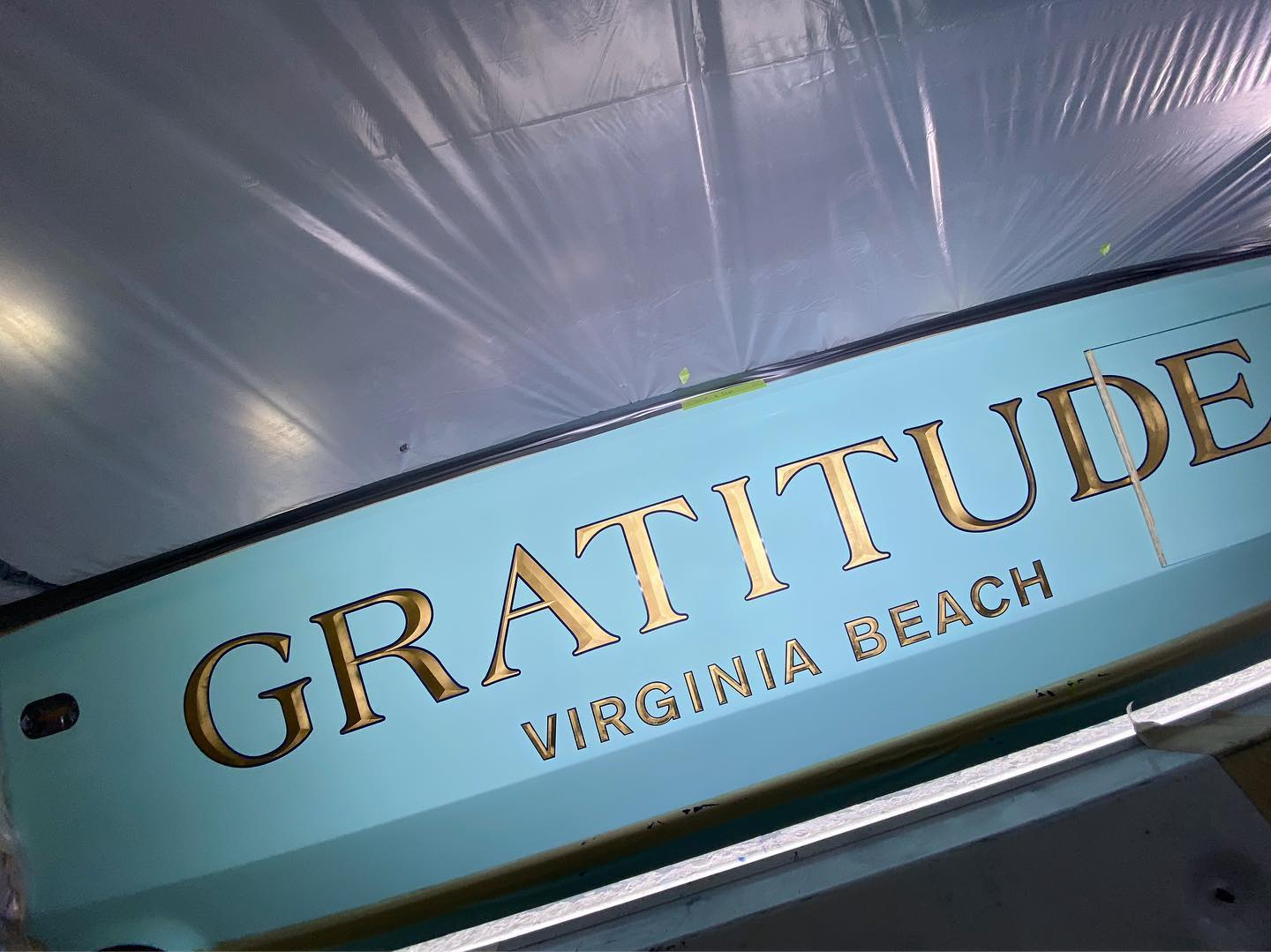 """""""Gratitude"""" a brand new 60' Spencer features our 23k yellow gold headline and hailing port characters in our bevel style with blue outlines. Their slogan: """"Gratitude changes everything."""""""