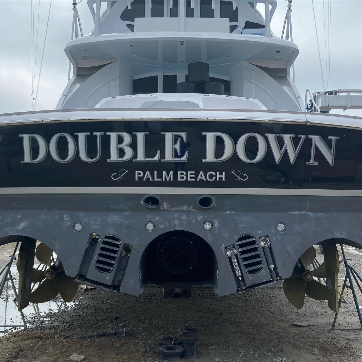 Hull color was considered with the design of this hand painted name for Double Down. Everett Nautical always utilizes some color of each vessel into it's respective name design to create a cohesive look. Double Down's name features painted highlight and shadow letter fills with a silver outline, complete with custom designed hailing port graphics.   The 86' enclosed fly bridge, Double Down, is Tribute's largest boat to date. Double Down launched in 2008 and was designed and engineered by Applied Concepts.   All work completed at Jarrett Bay Boatworks, Beaufort, NC.