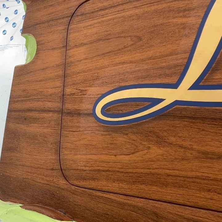 Lights Out, a Bayliss 65', was recently painted by the Everett Nautical crew in 2021. This name features a script typeface with blue painted outlines, engine turned 23k yellow gold leaf letter fills with soft drop shadows. All work completed at Bayliss Boatworks, Wanchese, NC.