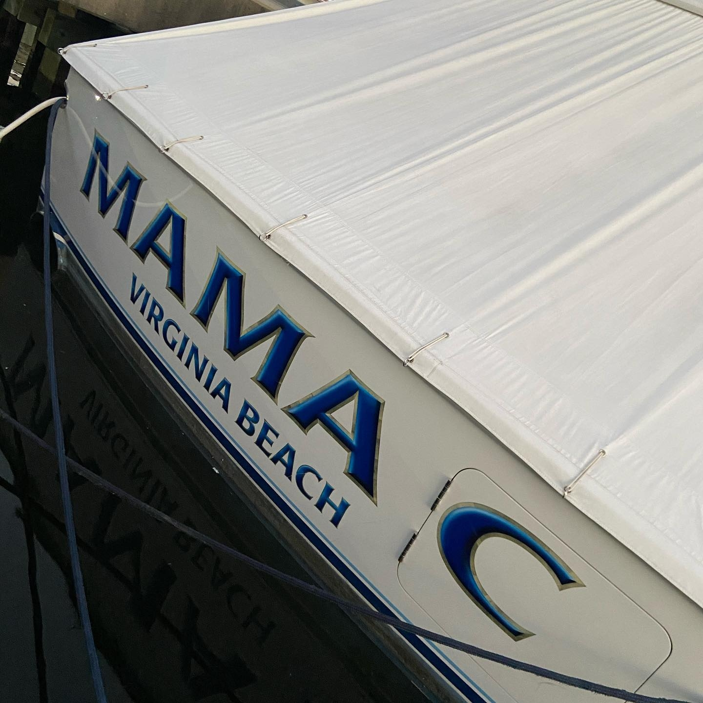 Mama C is a 60' Bayliss sport fishing boat painted by Everett Nautical. This name features a blue highlight and shadow letter fill with white gold leaf outlines. All work completed at Bayliss Boatworks, Wanchese, NC.